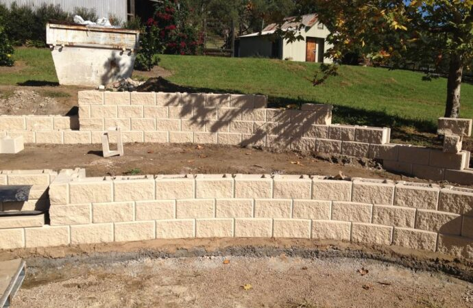 Retaining & Retention Walls-Flower Mound TX Professional Landscapers & Outdoor Living Designs-We offer Landscape Design, Outdoor Patios & Pergolas, Outdoor Living Spaces, Stonescapes, Residential & Commercial Landscaping, Irrigation Installation & Repairs, Drainage Systems, Landscape Lighting, Outdoor Living Spaces, Tree Service, Lawn Service, and more.